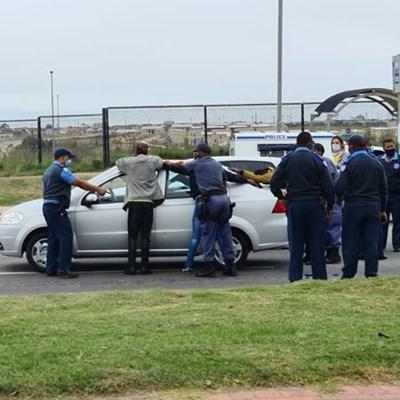 4 apprehended after car speeds off