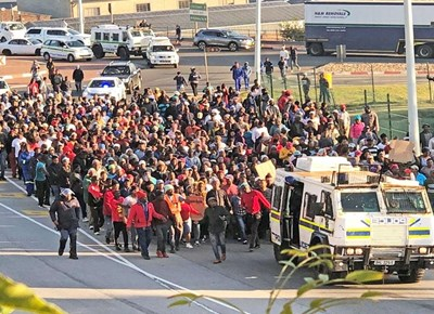 Protesters damage businesses
