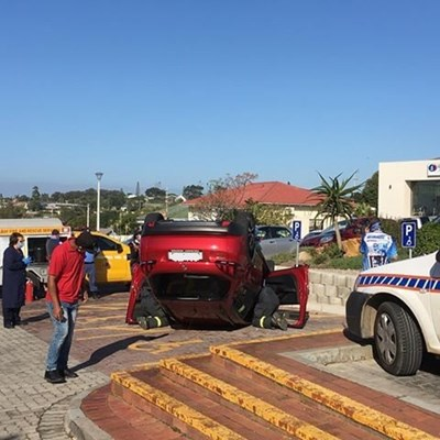 Car lands on its roof at hospital