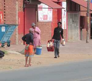 Scenes of chaos as protesters loot local shops