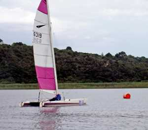 Wind plays cat and mouse with sailors on Island Lake