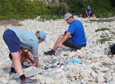 Beachcombers clean the beach in support of Strandloper Project