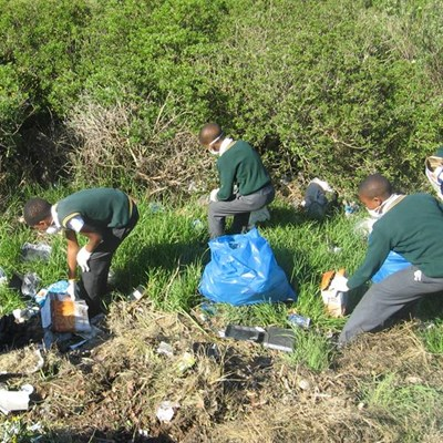 Learners help with clean-up operation