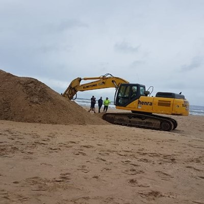 Preparations to breach river mouth