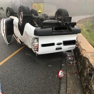 Vehicle overturns on pass
