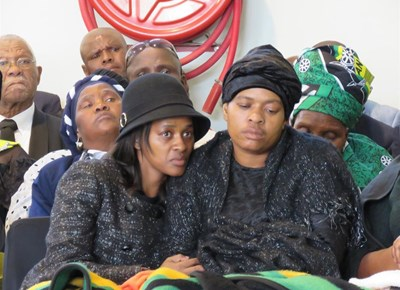 Mourners grieve as Victor Molosi is laid to rest
