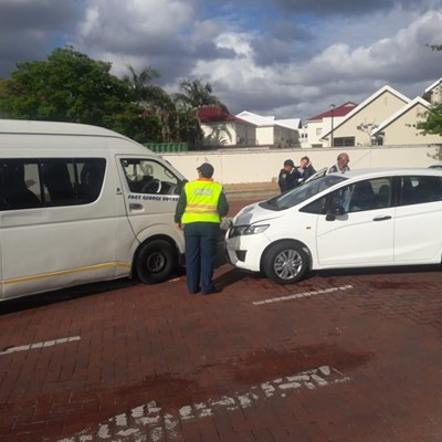 Taxi and car in head-on collision