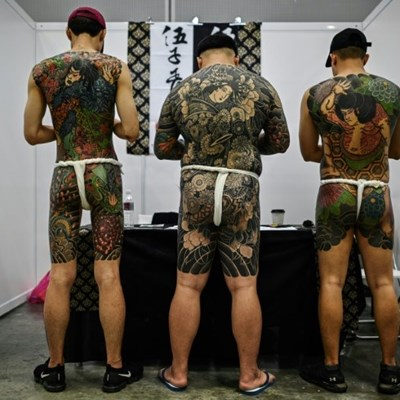 Malaysia slams tattoo expo as 'porn' over half-naked pics