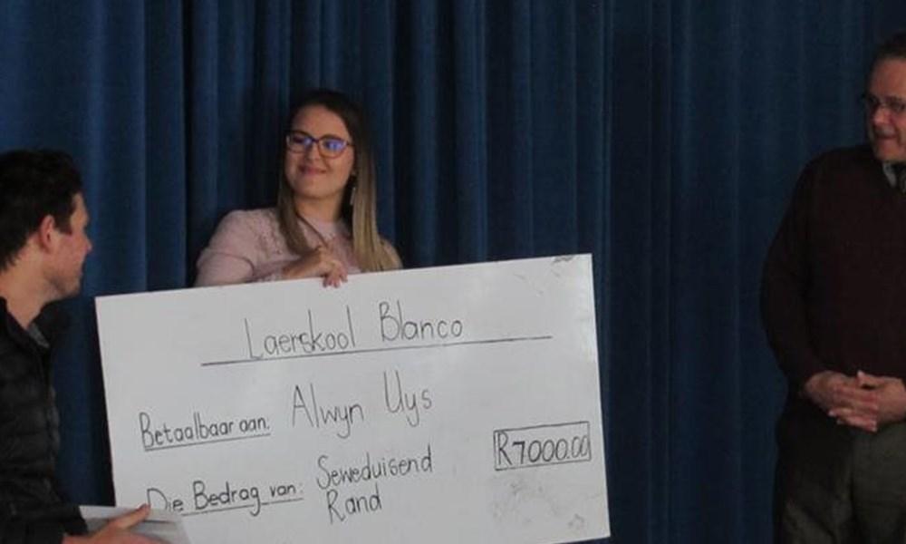 Rrolstoelatleet Alwyn Uys besoek Laerskool Blanco