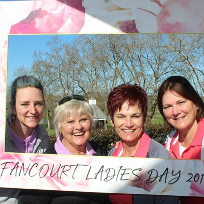 Lady golfers celebrate with pink champagne