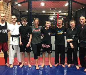 Fighters obtain their black belts