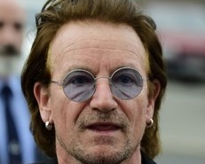 Bono says he's 'back to full voice', U2 tour will resume