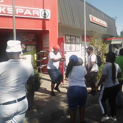 Axed Spar workers protest at storefront