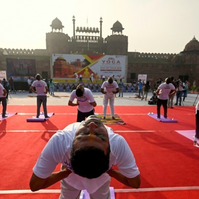 Free Covid vaccines for all Indian adults as Modi hails yoga 'shield'