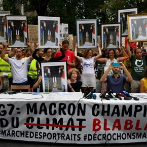 Anti-G7 activists march with 'stolen' Macron portraits