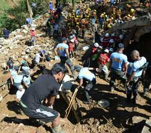 Grim search for typhoon landslide victims