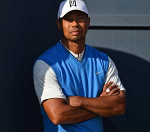 Woods finds his Open return a pain in the neck