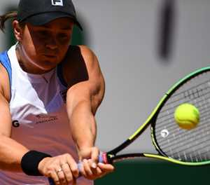 Top seed Barty overcomes scare to reach French Open second round