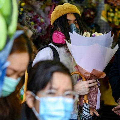 Virus-hit Hong Kong says it with face masks, not flowers