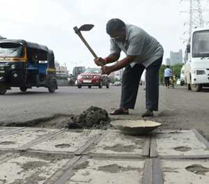 Indian man fills potholes out of love for dead son