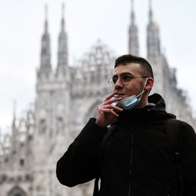 Choked-up Milan takes smoking ban outside