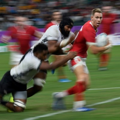 Wales tame ferocious Fiji to reach World Cup quarter-finals