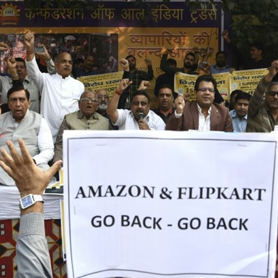 Amazon tycoon Bezos flies into internet trading storm in India