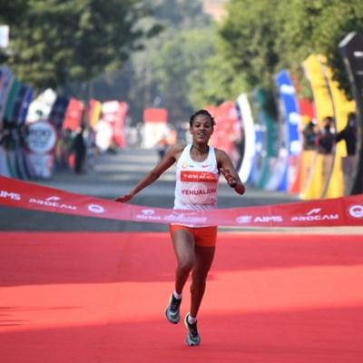 Top runners brave pollution, pandemic in Delhi half marathon