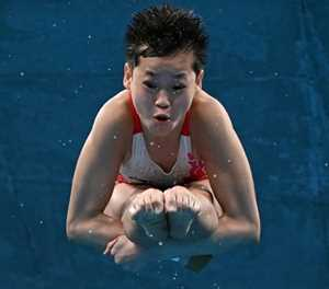 China's Quan, 14, wins Olympic gold with three perfect dives