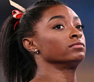 Biles' Olympic fate in balance as support pours in