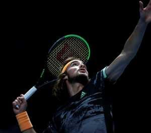 Tsitsipas reaches ATP Finals semis after Nadal comeback