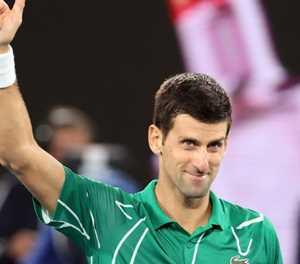 Djokovic keeps focus to set up Federer semi-final