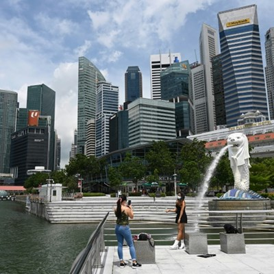 Singapore tightens virus curbs after infections spike