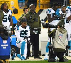 NFL protest kneeler Reid signs three-year Panthers deal