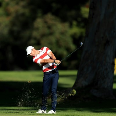 McIlroy closes in on Kuchar, Woods lags at Riviera