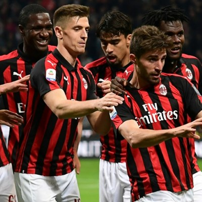 Milan back in Champions League race after fiery Bologna win