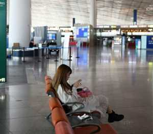 Chinese students fleeing virus face uneasy reception back home