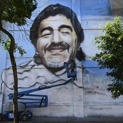 Street artist unveils mural to 'Saint' Diego Maradona