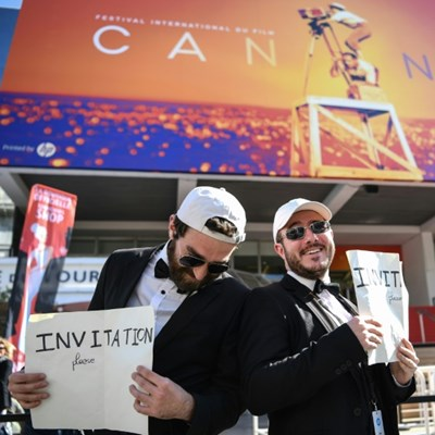With tent plus tuxedo, fans camp out to catch Cannes