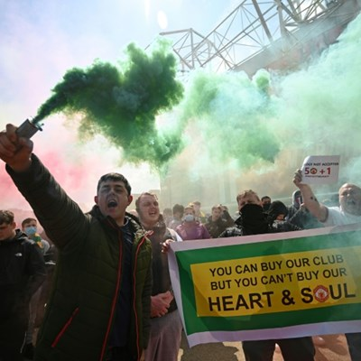 Man Utd fans storm Old Trafford pitch in anti-Glazer protest