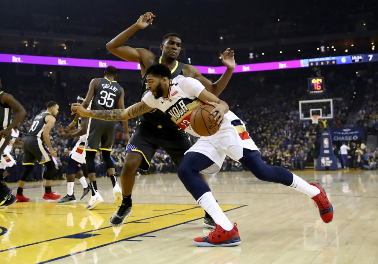 2b5f7225e92 Anthony Davis of the New Orleans Pelicans, driving on Golden State's Kevon  Looney, has reportedly given the Pelicans a list of teams where he would  sign a ...