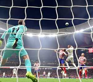 Real hold off Atletico in tight derby to grab top spot in Spain