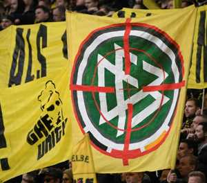 Football grinds to a halt as Bundesliga banner insults escalate
