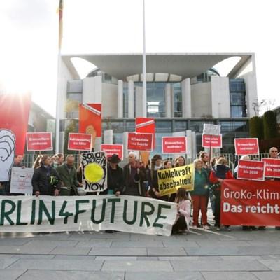 Marathon Merkel govt talks drag as climate deal proves elusive