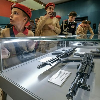 Russian cadets pose for selfies at Kalashnikov exhibition