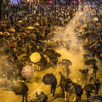 Hong Kong siege in third day as China sounds warnings