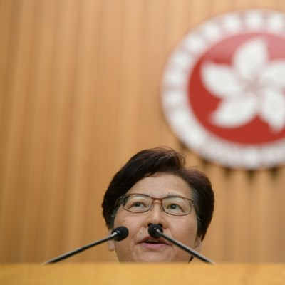 Hong Kong leader insists she will stay on
