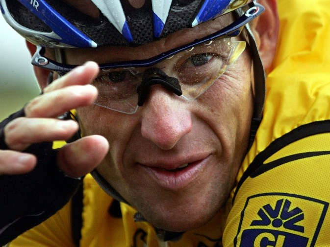 Lance Armstrong settles case
