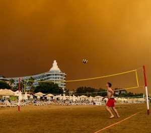 Forest fires rage near Turkish resorts, killing four