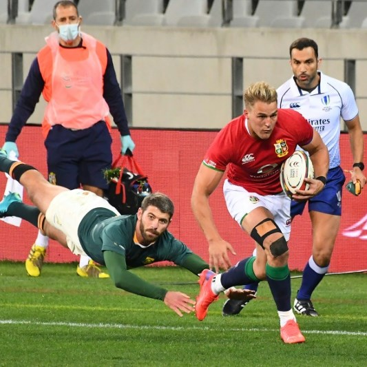 Farrell seals Lions' victory in bruising battle with Springboks